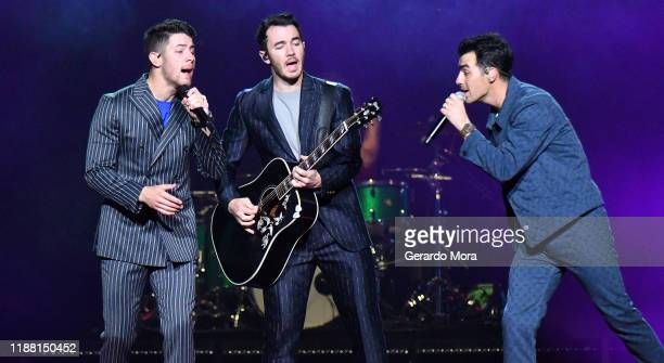 Joe Jonas Kevin Jonas and Nick Jonas perform onstage during Jonas Brothers Happiness Begins Tour at Amway Center on November 16 2019 in Orlando...