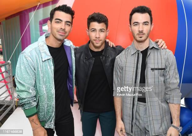Joe Jonas Nick Jonas and Kevin Jonas of Jonas Brothers attend FOX's Teen Choice Awards 2019 on August 11 2019 in Hermosa Beach California