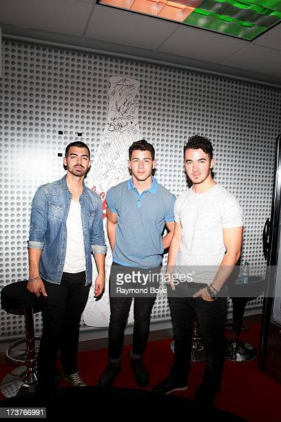Joe Jonas Nick Jonas and Kevin Jonas of The Jonas Brothers poses for photos in the KISSFM 'CocaCola Lounge' in Chicago Illinois on JULY 10 2013