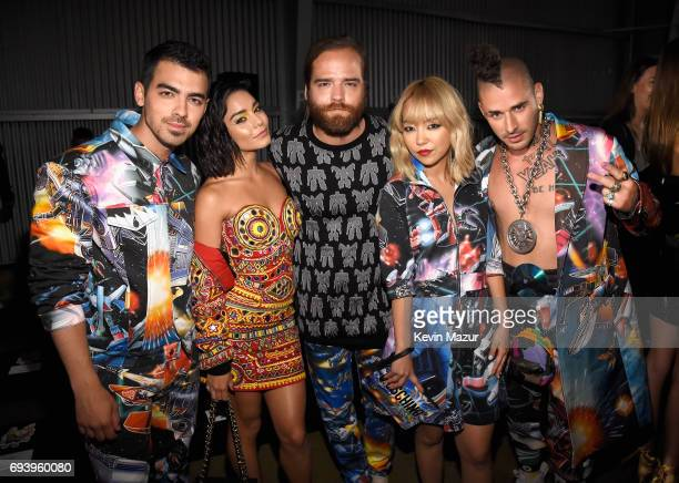 Joe Jonas of DNCE actor Vanessa Hudgens Jack Lawless JinJoo Lee and Cole Whittle of DNCE attend Moschino Spring/Summer 18 Menswear and Women's Resort...