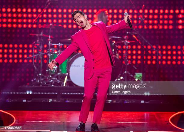 """Joe Jonas performs onstage during Jonas Brothers: """"Happiness Begins"""" Tour at Little Caesars Arena on September 07, 2019 in Detroit, Michigan."""