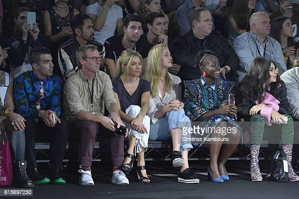 Joe Jonas Spike Jonze Sienna Miller Lupita Nyong'o and Charli XCX sit front row at KENZO x HM Launch Event Directed By JeanPaul Goude' at Pier 36 on...