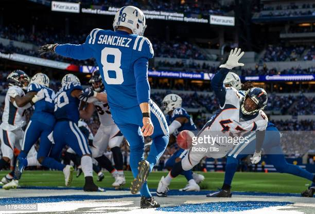 Joe Jones of the Denver Broncos attempts to block a punt from Rigoberto Sanchez of the Indianapolis Colts during the third quarter of the game at...