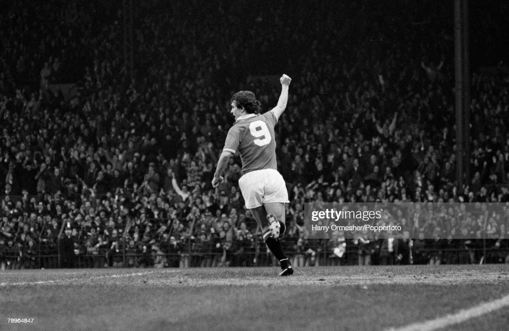 22nd December 1979. Old Trafford, Manchester. Manchester United 3 v Nottingham Forest 0. Manchester United+s Joe Jordan turns away and salutes the United supporters after scoring one of his two goals. : News Photo