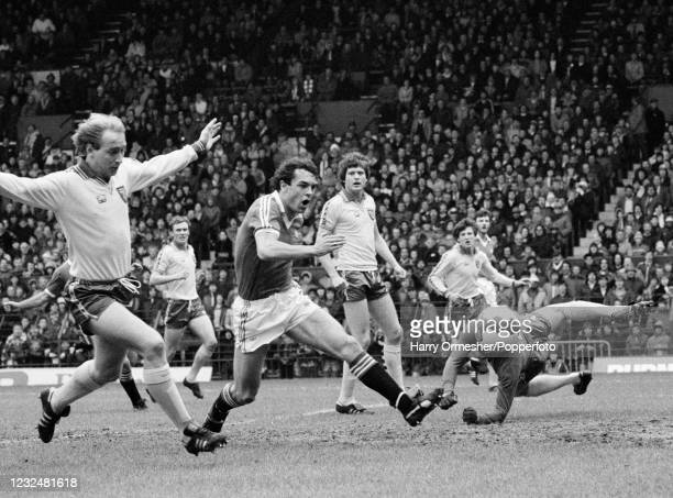Joe Jordan of Manchester United scores past Norwich City goalkeeper Chris Woods during a Football League Division One match at Old Trafford on April...