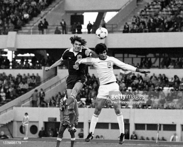 Joe Jordan of Scotland out jumps an Iranian defender during a FIFA World Cup Group 4 match at the Estadio Chateau Carreras on June 7, 1978 in...