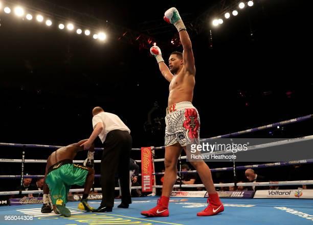 Joe Joyce celebrates victory as the referee checks on Lenroy Thomas during the Commonwealth Heavyweight Title fight between Lenroy Thomas and Joe...