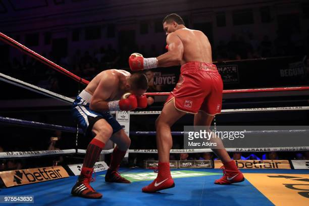 Joe Joyce knocks down Ivica Bacurin during the Commonwealth Heavyweight Title fight between Joe Joyce and Ivica Bacurin at York Hall on June 15 2018...