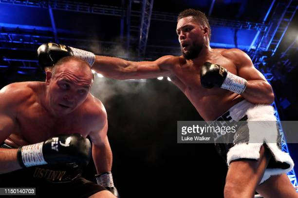 Joe Joyce MBE punches Alexander Ustinov during the International Heavyweight Contest at The Lamex Stadium on May 18 2019 in Stevenage England