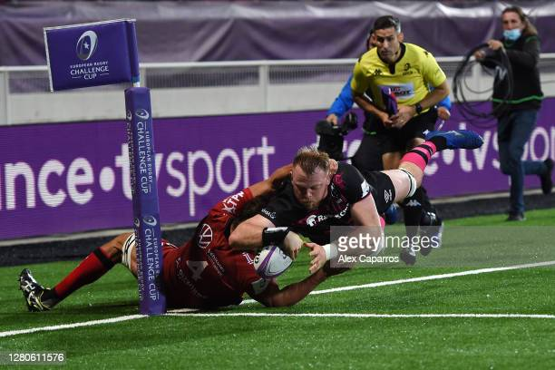 Joe Joyce of Bristol Bears dives over for a try tackled by Eben Etzebeth of RC Toulon which was later ruled out for a forward pass during the...