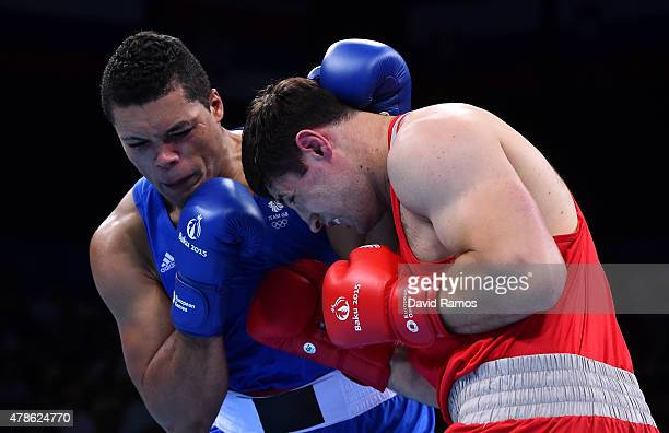 Joe Joyce of Great Britain and Gasan Gimbatov of Russia compete in the Men's Boxing Super Heavyweight Final during day fourteen of the Baku 2015...