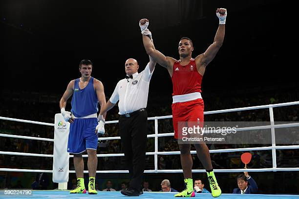 Joe Joyce of Great Britain celebrates after defeating Bakhodir Jalolov of Uzbekistan in the Men's Super Heavy Quarterfinal 3 on Day 11 of the Rio...