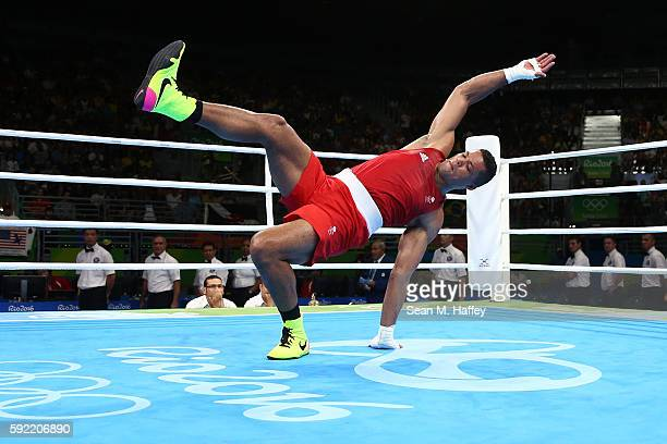 Joe Joyce of Great Britain celebrates after defeating Ivan Dychko of Kazakhstan in the Men's Super Heavy Semifinal 2 on Day 14 of the Rio 2016...