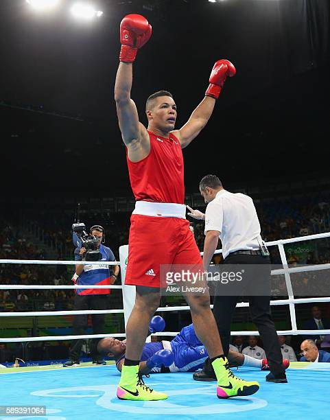 Joe Joyce of Great Britain celebrates knocking out Davilson Dos Santos Morais of Cape Verde during the Men's Super Heavyweight preliminaries on Day 8...