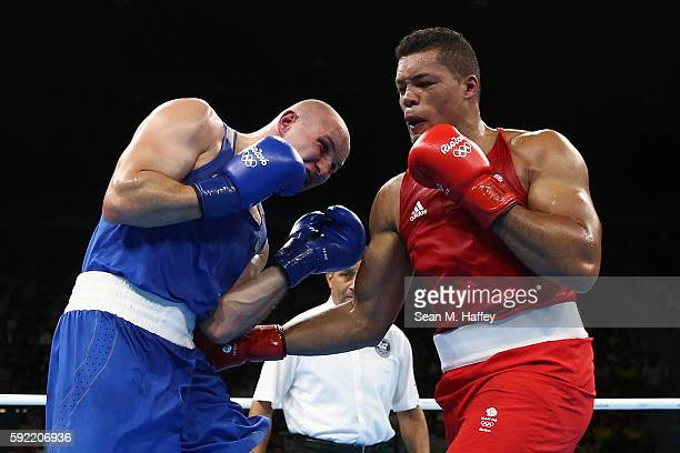Joe Joyce of Great Britain fights Ivan Dychko of Kazakhstan in the Men's Super Heavy Semifinal 2 on Day 14 of the Rio 2016 Olympic Games at the...