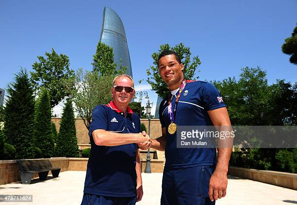 Joe Joyce of Great Britain is congratulated on his gold medal by Mark England Chef de Mission of Team GB following the Men's Boxing Super Heavyweight...