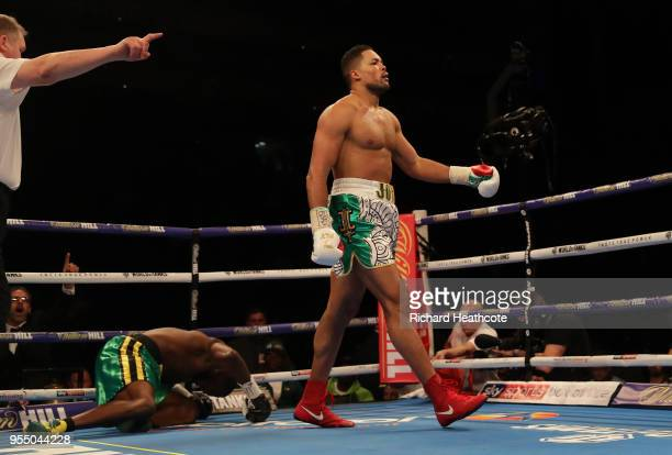 Joe Joyce walks down to the corner as he knocks down Lenroy Thomas in the first round during the Commonwealth Heavyweight Title fight between Lenroy...