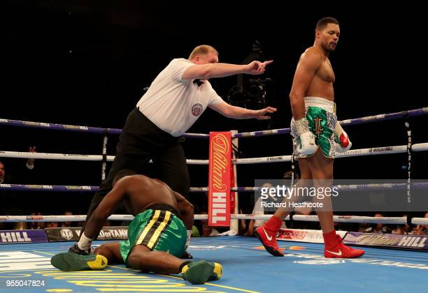 Joe Joyce walks to the corner as the referee counts down Lenroy Thomas during the Commonwealth Heavyweight Title fight between Lenroy Thomas and Joe...