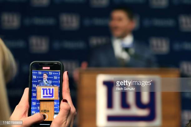 Joe Judge is photographed by a reporter as he talks to the media after he was introduced as the new head coach of the New York Giants during a news...