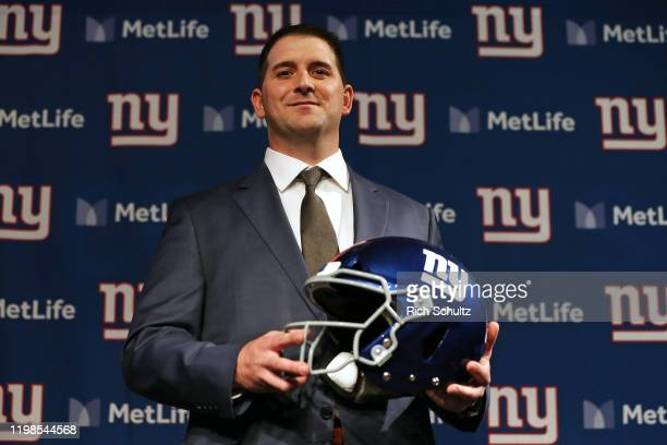 Joe Judge poses with a helmet after he was introduced as the new head coach of the New York Giants during a news conference at MetLife Stadium on...