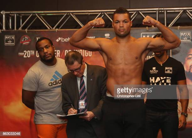 Joe Juggernaut Joyce poses for the camera's as he weighs in watched by his oppointent Ian Lay em out Lewison during the Hayemaker Ringstar Fight...