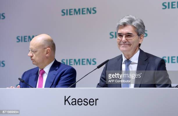 Joe Kaeser CEO of German industrial conglomerate Siemens and Ralf P Thomas CFO of the group give the annual results press conference on November 9...
