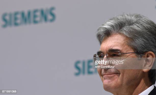 Joe Kaeser CEO of German industrial conglomerate Siemens smiles during the annual results press conference on November 9 2017 in Munich southern...