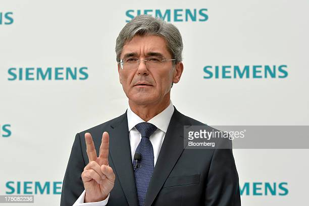 Joe Kaeser chief executive officer of Siemens AG gestures as he speaks during a news conference after being named as the new chief executive of the...