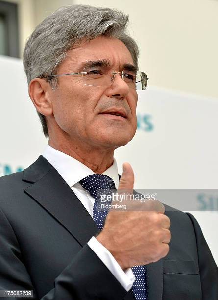 Joe Kaeser chief executive officer of Siemens AG gestures during a news conference after being named as the new chief executive of the company in...