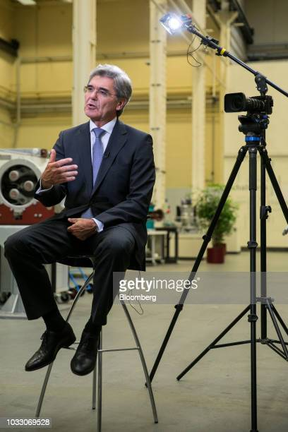 Joe Kaeser chief executive officer of Siemens AG gestures while speaking during a Bloomberg Television interview on the factory floor at the Siemens...