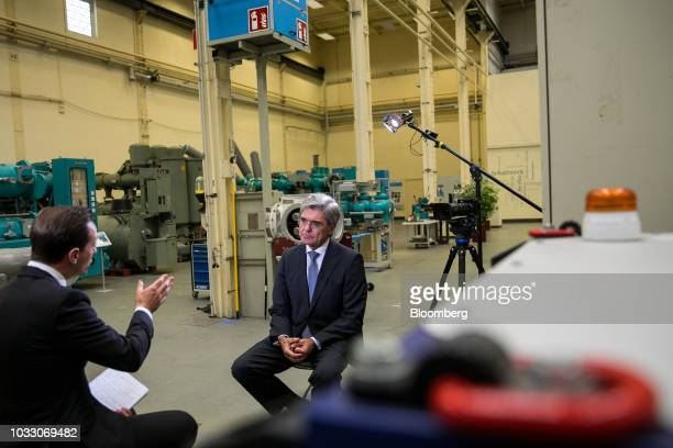 Joe Kaeser chief executive officer of Siemens AG listens during a Bloomberg Television interview on the factory floor at the Siemens switchgear...