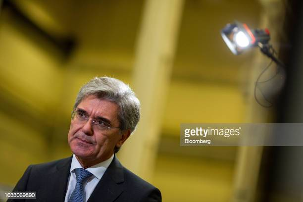 Joe Kaeser chief executive officer of Siemens AG pauses during a Bloomberg Television interview on the factory floor at the Siemens switchgear...