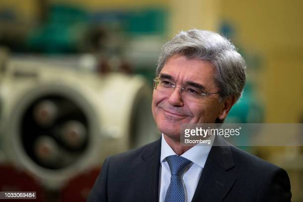 Joe Kaeser chief executive officer of Siemens AG reacts during a Bloomberg Television interview on the factory floor at the Siemens switchgear...