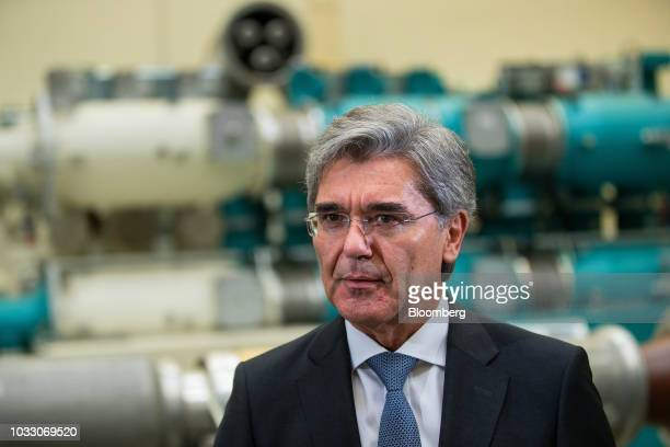 Joe Kaeser chief executive officer of Siemens AG speaks during a Bloomberg Television interview on the factory floor at the Siemens switchgear...