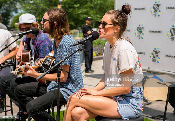 Joe Keefe and Christina Schroeter of Family on the Year performs during PopUp FEQ surprise show outside the Quebec Parliment on July 10 2015 in...
