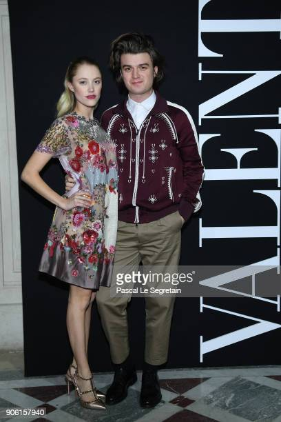 Joe Keery and his girlfriend Maika Monroe attend the Valentino Menswear Fall/Winter 20182019 show as part of Paris Fashion Week on January 17 2018 in...