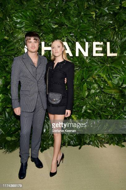 Joe Keery and Maika Monroe attend Chanel Dinner Celebrating Gabrielle Chanel Essence With Margot Robbie on September 12, 2019 in Los Angeles,...
