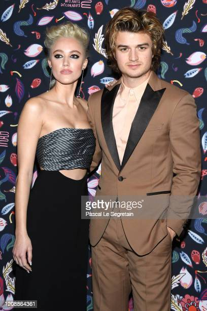 Joe Keery and Maika Monroe attend the Harper's Bazaar Exhibition as part of the Paris Fashion Week Womenswear Fall/Winter 2020/2021 At Musee Des Arts...