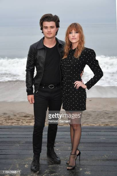 Joe Keery and Maika Monroe attend the Saint Laurent Mens Spring Summer 20 Show on June 06, 2019 in Paradise Cove Malibu, California.