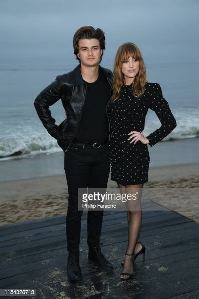 Joe Keery and Maika Monroe attend the Saint Laurent Mens Spring Summer 20 Show on June 06 2019 in Malibu California