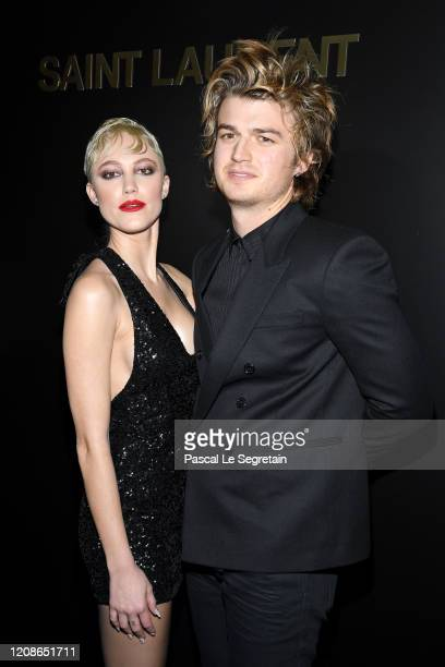 Joe Keery and Maika Monroe attend the Saint Laurent show as part of the Paris Fashion Week Womenswear Fall/Winter 2020/2021 on February 25 2020 in...