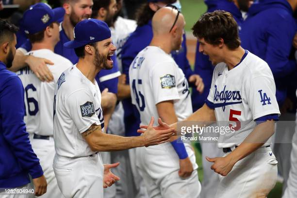 Joe Kelly and Corey Seager of the Los Angeles Dodgers celebrate after defeating the Tampa Bay Rays 3-1 in Game Six to win the 2020 MLB World Series...