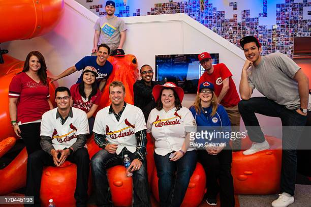 Joe Kelly and Trevor Rosenthal of the St Louis Cardinals pose with the Cave Dwellers and the Cave Crashers at the MLB Fan Cave Wednesday June 12 at...