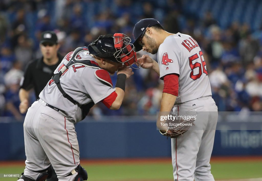 Joe Kelly #56 of the Boston Red Sox celebrates a victory with Christian Vazquez #7 after MLB game action against the Toronto Blue Jays at Rogers Centre on August 30, 2017 in Toronto, Canada.