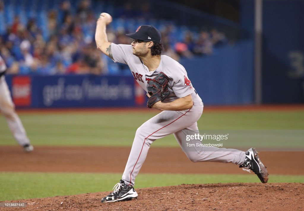 Joe Kelly #56 of the Boston Red Sox delivers a pitch in the ninth inning during MLB game action against the Toronto Blue Jays at Rogers Centre on August 8, 2018 in Toronto, Canada.