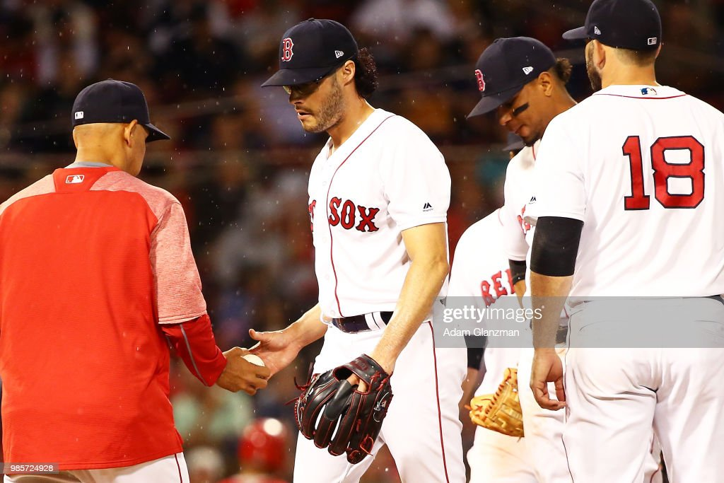 Joe Kelly #56 of the Boston Red Sox is taken out of the game in the seventh inning by Manager Alex Cora during a game against the Los Angeles Angels at Fenway Park on June 27, 2018 in Boston, Massachusetts.