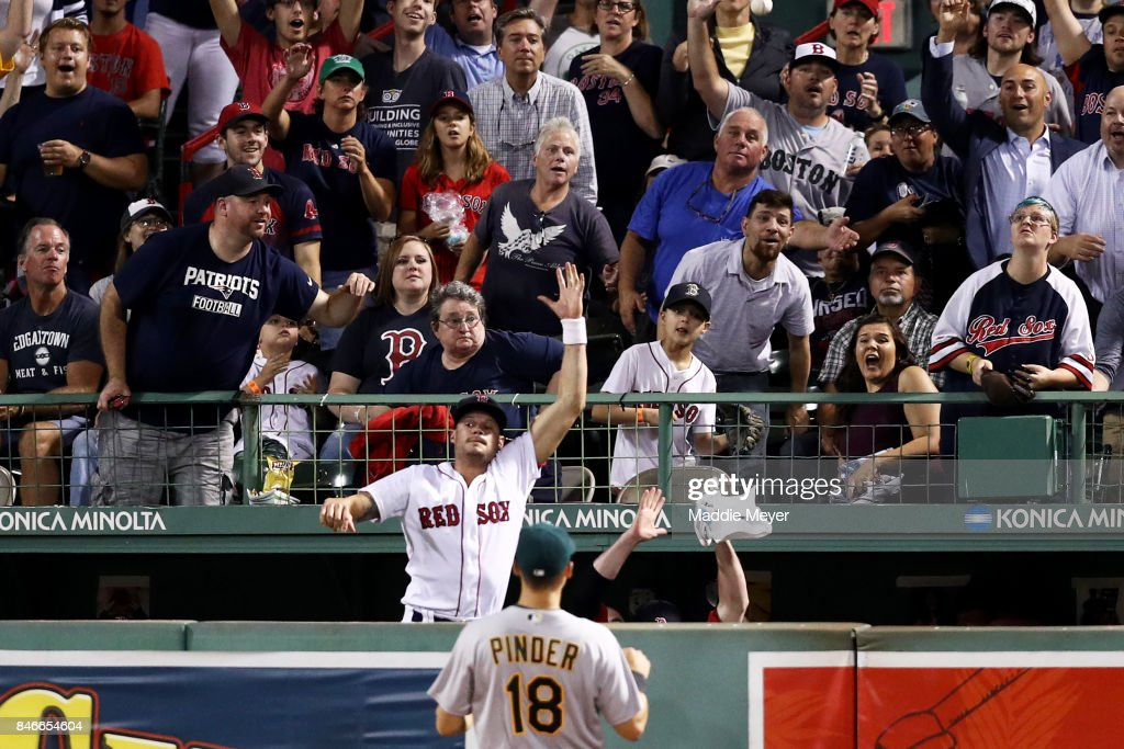 Joe Kelly #56 of the Boston Red Sox jumps from the bullpen to try and catch a home run hit by Jackie Bradley Jr. #19 during the fifth inning against the Oakland Athletics at Fenway Park on September 13, 2017 in Boston, Massachusetts.