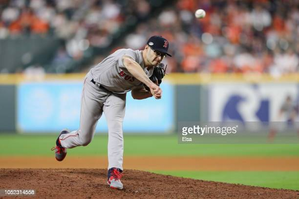 Joe Kelly of the Boston Red Sox pitches in the eighth inning against the Houston Astros during Game Three of the American League Championship Series...