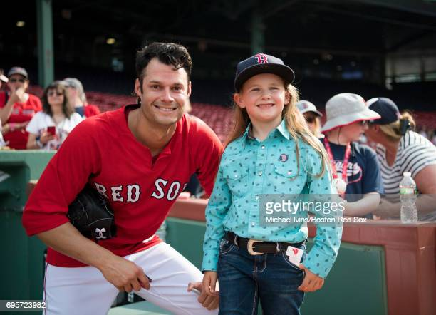 Joe Kelly of the Boston Red Sox poses for a photograph with Macey Hensley, a frequent guest on the Ellen DeGeneres show, at Fenway Park on June 13,...