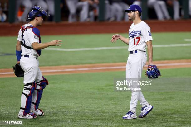 Joe Kelly of the Los Angeles Dodgers celebrates with Austin Barnes after closing out the teams 83 victory against the Tampa Bay Rays in Game One of...